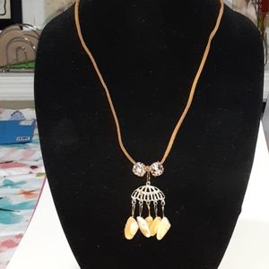 Seashell jewelry gold accents Amber cord necklace